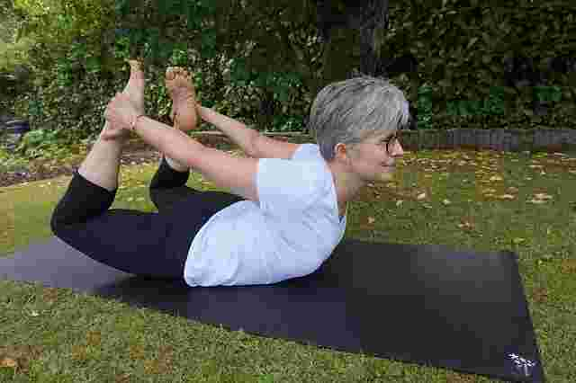 older woman in a yoga pose